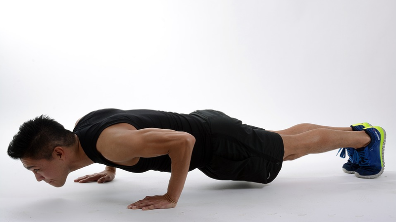 Man performing push up as part of free bodyweight workout for beginners